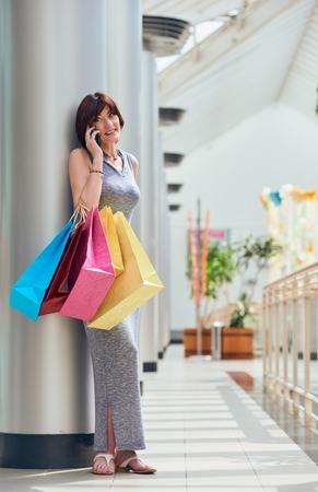 shopper: Shopper talking on phone