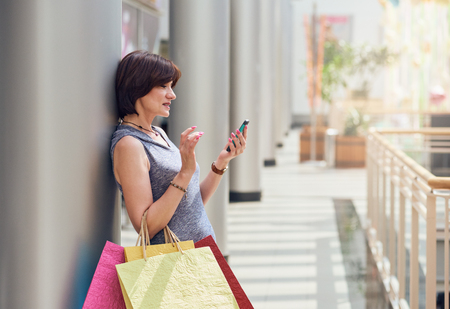 Shopper with smartphone photo