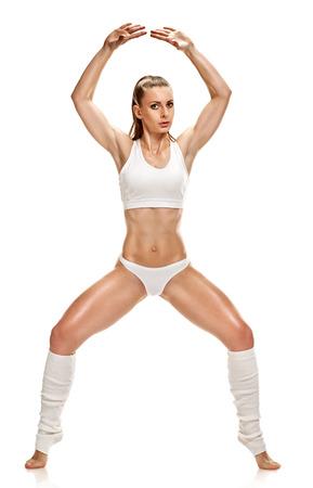 mujer deportista: Ejercicios de estiramiento chica Foto de archivo