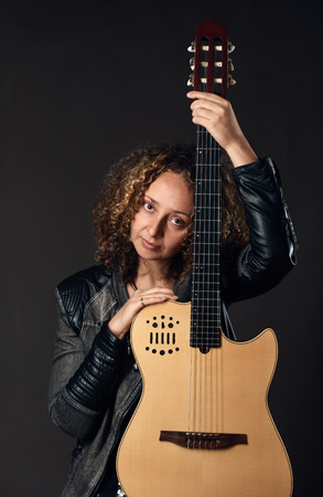 instrumentalist: Woman with classical guitar portrait