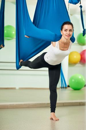 acrobatics: Fly yoga pretty girl