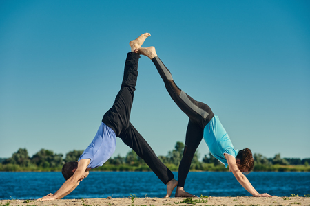 eka: Couple practicing acroyoga Stock Photo