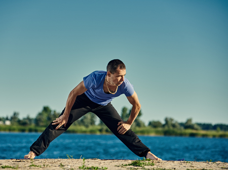 yoga man outdoor Stock Photo