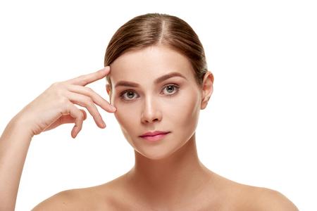 Woman touching brow Stock Photo