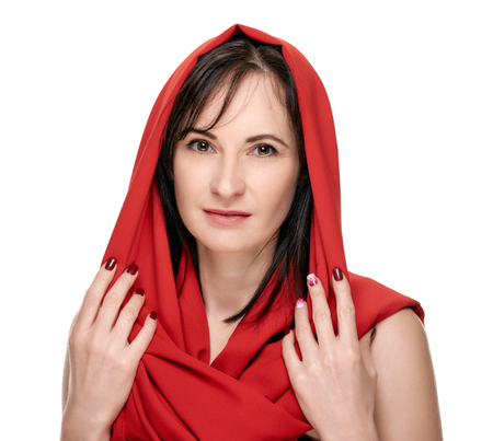 Woman in red headscarf Stock Photo