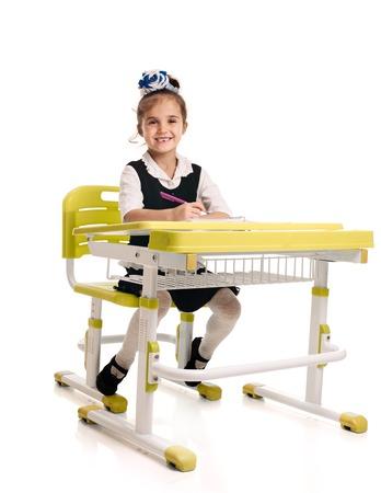 Cheerful schoolgirl studying