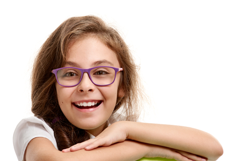 smiling Cute schoolgirl in glasses