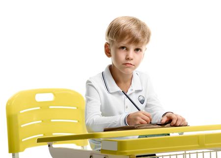 Schoolboy sitting at the desk