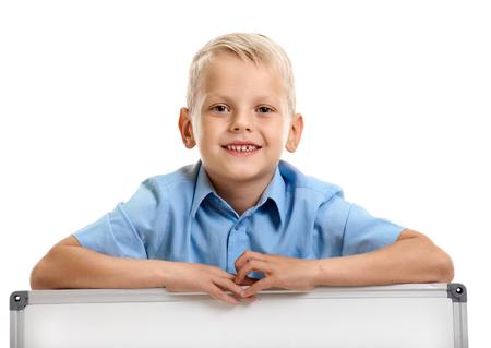 Schoolboy with whiteboard Фото со стока