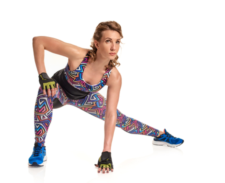 cross legs: Doing stretching exercise Stock Photo