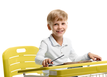 Schoolboy enjoying lesson Stock Photo