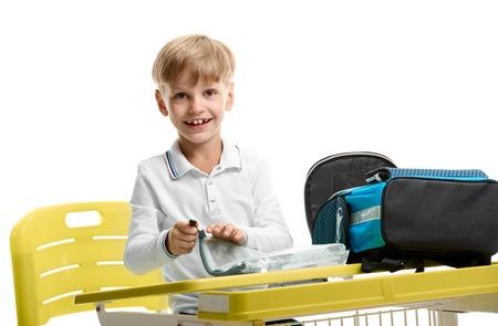 pupil Boy packing schoolbag