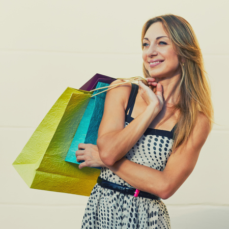 shopper: Glad pretty female shopper