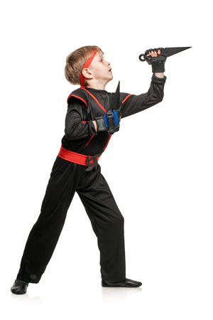throwing knife: Training boy with martial weapon Stock Photo