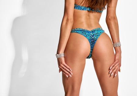 Female butt in bikini Фото со стока
