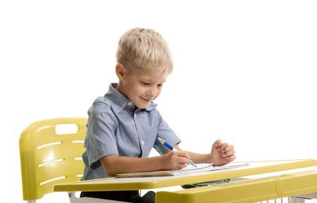 Smiling schoolboy writing Stock Photo
