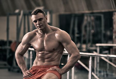 Bodybuilder posing in the gym