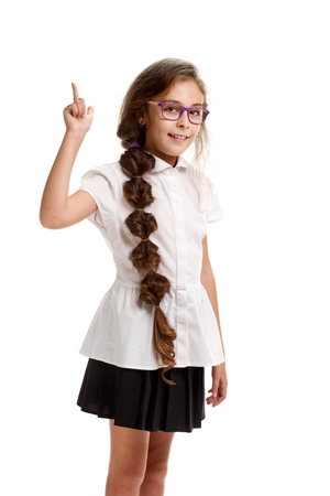 Schoolgirl showing direction Stock Photo