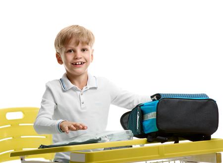 Boy packing schoolbag