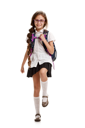 pretty Schoolgirl with bag marching Stock Photo - 82439605
