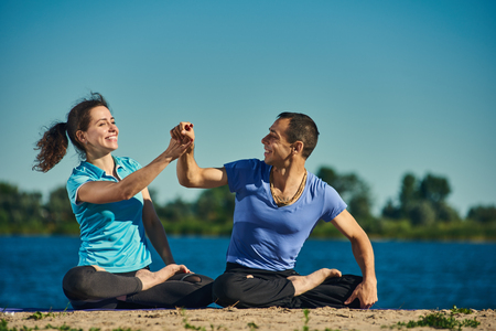 happy Practicing lotus position couple