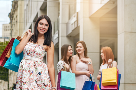 Happy shoppers with purchases Stock Photo