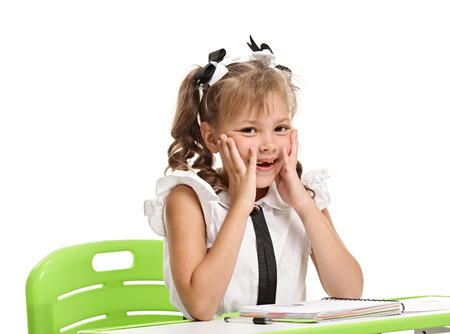 Cheerful girl at the desk