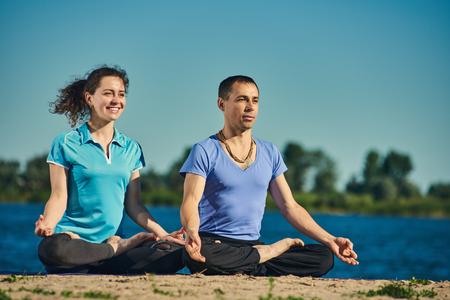 Practicing lotus position couple