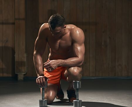 Fitness exercises with dumbbells Stock Photo