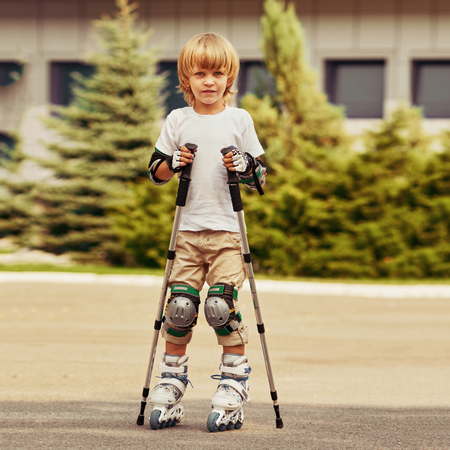 blond Boy learning rollerblading