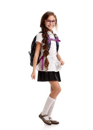 merry Schoolgirl with bag marching Stock Photo
