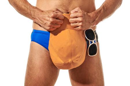 bather: Swimmer holding cap Stock Photo