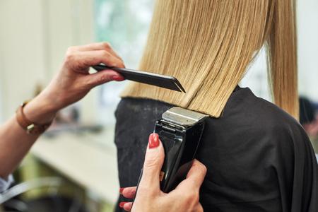 Stylist doing haircut