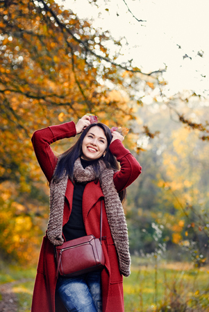 stroll: Joyful woman with leaves
