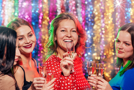 Women friends toasting at party Stock Photo