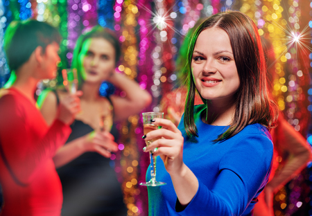 Woman with champagne at party