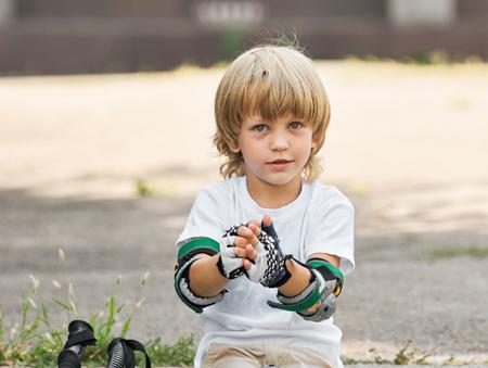 Skater taking off gloves