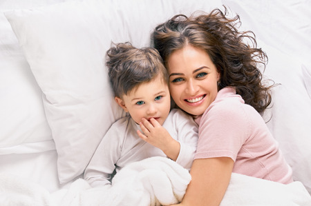 Cute happy mother with son Standard-Bild