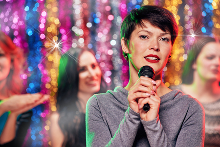 short haircuted brunette Woman singing