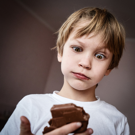 Funny boy with chocolate