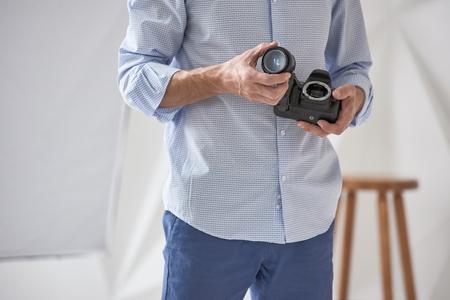 Photographer checking lens Stock Photo