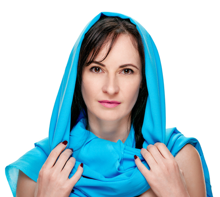 Portrait of pretty sensual woman wearing blue shawl
