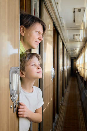 Mother and son in train Banco de Imagens