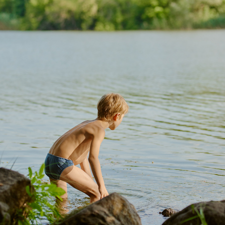 Boy near river Standard-Bild