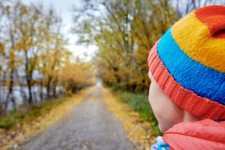 Woman on autumn road