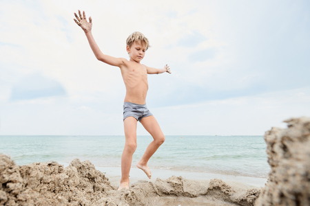 Child playing on the seashore