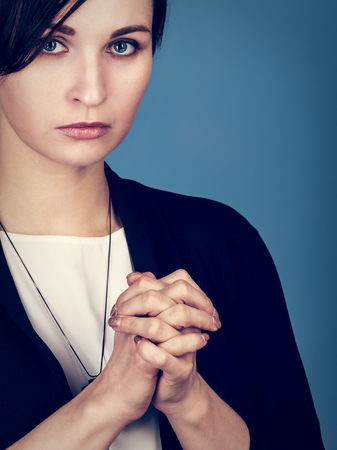 Concentrated woman praying Stock Photo