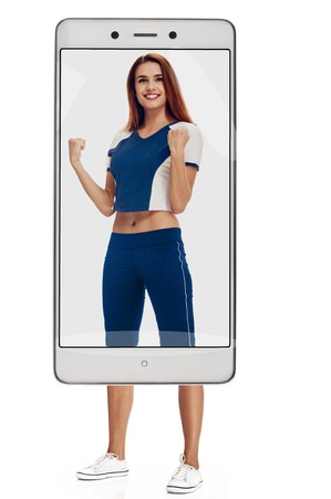 Cheerfully smiling woman doing exercise, full length isolated on white background. conceptual collage with device