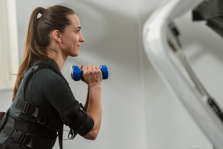 EMS training with dumbbells Archivio Fotografico