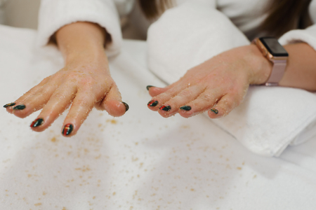 Female hands with scrub Imagens
